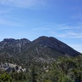Behind the towering sandstone cliff faces at Red Rock canyon lies a beautifully rugged landscape filled with limestone peaks, Pinyon and Juniper woodlands, and hidden mountain springs.- Bridge Mountain