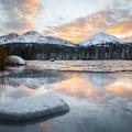 Sunrise reflected in the ice.- Manzanita Lake Loop Trail