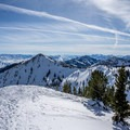Two skiers taking in the view.- Mount Tuscarora: The Seagull Chute