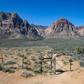 The trail begins at the bottom of the parking area behind an unsigned gate.- Oak Creek Canyon Trail