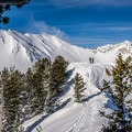 Two backcountry skiers assessing the ascent options.- Mount Superior Backcountry Skiing