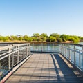 Floating boardwalk over Water Ranch Lake.- Riparian Preserve at Water Ranch
