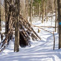 A wooden teepee on the side of the trail.- Stowe Pinnacle