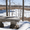 One of several stone memorial benches.- Thompson Pond Nature Preserve