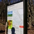 Signage at the Upper Hawksbill Parking Lot.- Hawksbill Summit Loop