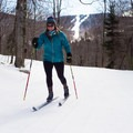 The downhill ski area can be seen from the trail.- Bolton Valley Nordic Center