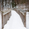 Portions of the boardwalk have railings for added security.- Thundering Brook Falls