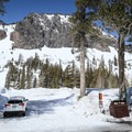Beneath the snow, the beginning of the trail isn't immediately obvious. It starts about midway through the lodge parking lot behind an easy-to-miss marker.- Twin Lakes Loop