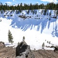 The lake at the base of the crater is frozen over in the winter.- Inyo Craters