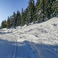 Snowmobile tracks along the trail.- Minaret Vista