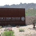 The entrance sign at the end of the paved road leading to Tom's Thumb Trailhead.- Tom's Thumb