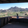 The rustic covered breezeway of the Scottsdale McDowell Sonoram Preserve at the Tom's Thumb Trailhead.- Tom's Thumb