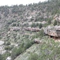 Canyon walls viewed from the Island Trail with numerous Native American houses built within them.- Walnut Canyon National Monument