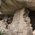 Adventurers observing the dwellings up close.- Walnut Canyon National Monument