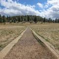 Developed walkway through an open meadow in Alderfer/Three Sisters Park- Alderfer/Three Sisters Park Loop