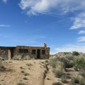 The rock house, built in 1929, is a testament to some hardy residents of the Mojave Desert.- Rock Springs Loop