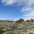 The rock house blends in with the arid landscape of the Mojave.- Rock Springs Loop