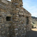 Look closely at the craftsmanship of the stout rock house.- Rock Springs Loop
