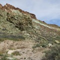 A massive green wall marks the beginning of the end of Owl Canyon.- Owl Canyon hike