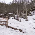 Left goes to the mid-level falls, right goes higher.- Kaaterskill Falls Snowshoe