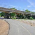 The bike path travels alongside train tracks and under freeways.- Sacramento Northern Bikeway