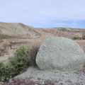 A green rock sits prominently in the campground.- Owl Canyon Campground