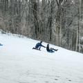 Getting a push down the slope.- Marlboro Elementary School Sledding