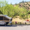 Small tent trailer parked at the recreation site.- Coon Bluff Campground