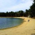 The main beach at Walden Pond.- Walden Pond + Adams Woods