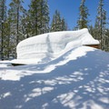 Heavy winter snows are visible along the trail.- Stagecoach Trail