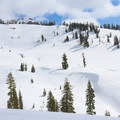 Vistas of snow-covered peaks across the creek.- Sulphur Works Snowshoe