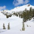 A saddle marks the edge of Ridge Lakes.- Ridge Lakes Snowshoe