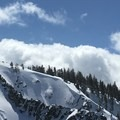 A snowboarder drops into the Halls of God.- Angora Peak: Northwest Gullies