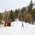 The trailhead is atop the snowbank and is restricted to human-powered traffic only, except when insufficient snow exists at the Hope Valley Sno-Park.- Red Lake / Forestdale Road