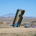 The Car Forest overlooking the old mining town of Goldfield in the background.- International Car Forest Of The Last Church