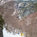 Early views of the steep chutes and huge cliffs of Mount Mansfield.- Smugglers Notch