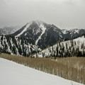 A gloomy Kessler Peak in the distance.- Mount Raymond Backcountry Skiing