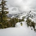 Treading carefully on the heavily corniced ridgeline.- Mount Raymond Backcountry Skiing