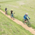 Mountain bikers in Russian Ridge Open Space Preserve.- Russian Ridge Open Space Preserve