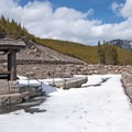 Gibbon Falls viewing platform under snow.- Grand Loop + West Yellowstone Tour