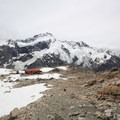 Mueller Hut, with Mount Sefton and Mount Cook as a spectacular background.- Mueller Hut Route