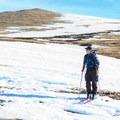 Navigating the dry patches toward James Peak.- James Peak: Shooting Star Couloir