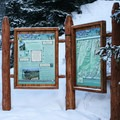 Signs at the trailhead, where the skin track begins.- Berthoud Pass Ski Area