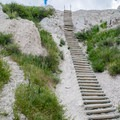 A wooden ladder leading to the top portion of the trail.- Notch Trail