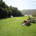 Campsite area on the Heaphy Hut grounds.- New Zealand Great Walks: Heaphy Track