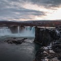 Hardened lava outcroppings stick out into the falls.- Goðafoss