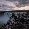 A low sun over the falls in late fall.- Goðafoss