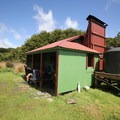Gouland Downs Hut is one of the older huts on the Heaphy Track.- New Zealand Great Walks: Heaphy Track