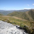 As this picture shows, Perry Saddle Hut  lives up to its name. It is located right at the saddle of two mountains. This picture is taken halfway up Mount Perry.- New Zealand Great Walks: Heaphy Track