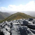 The view from the summit of Mount Perry looking west toward the Gouland Downs.- New Zealand Great Walks: Heaphy Track